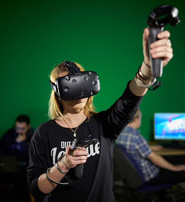 Young woman using Virtual Reality equipment