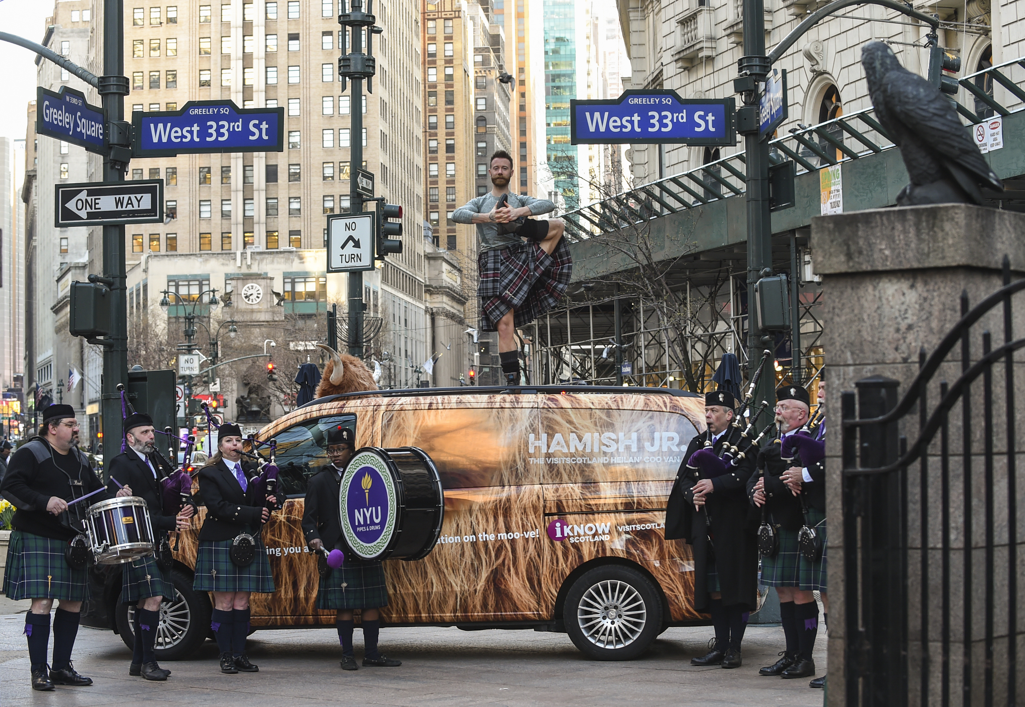 Hamish The Coo van & man doing yoga in a kilt in NYC