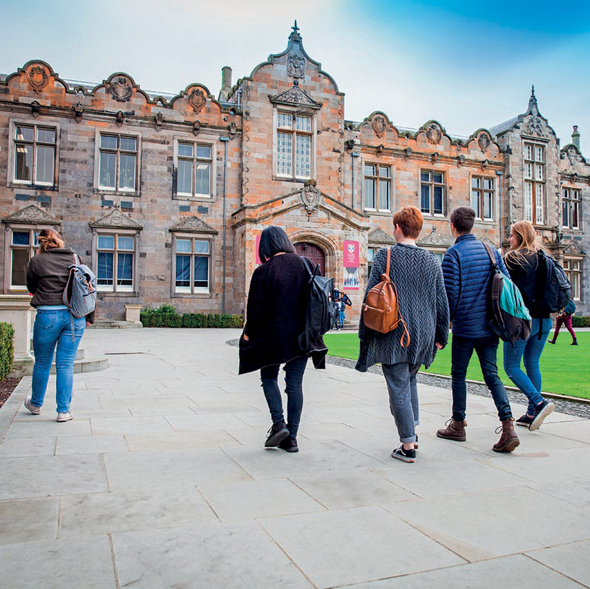 Image of students walking through St Andrews University's historic campus
