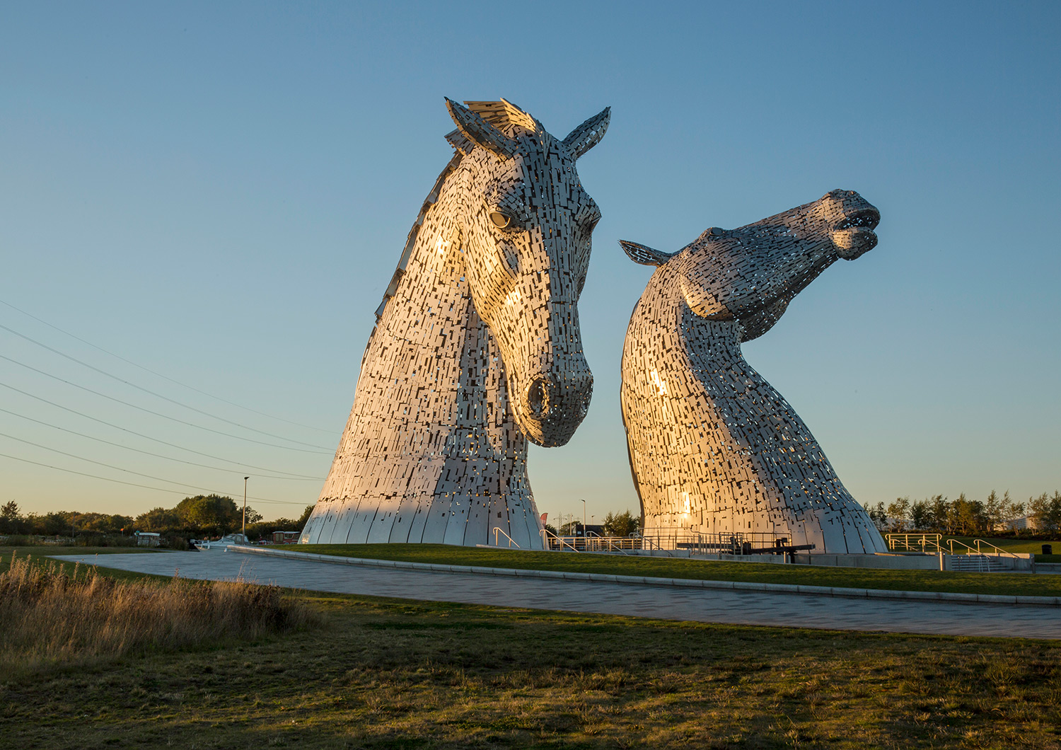 Two 30ft steel sculptures of horses heads